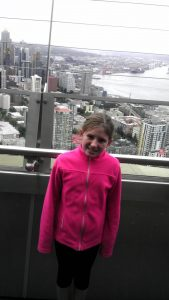 Nine-year-old Claire at the top of the Space Needle.